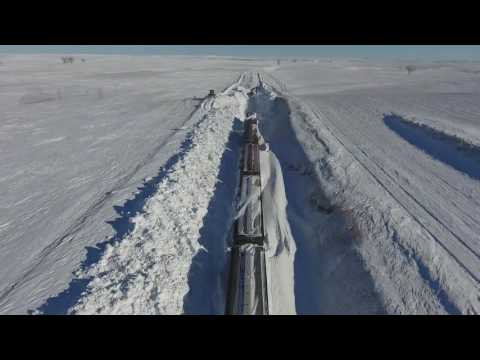 Thumbnail: BNSF employees clear tracks of heavy snow