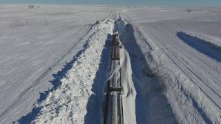 BNSF employees clear tracks of heavy snow