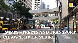 Empty streets and transport chaos amid Hong Kong citywide strike