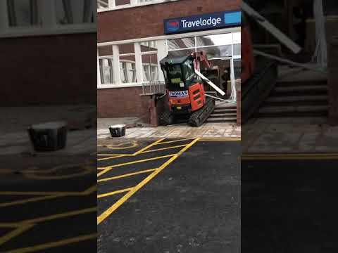 Don Action Jackson - Angry Unpaid Construction Worker Drives Excavator into Building (NSFW)