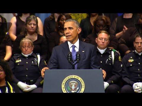 Obama tells memorial US 'not as divided as we seem'