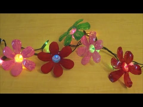 Recycle plastic water bottle flowers youtube for Images of decorative items made from waste material