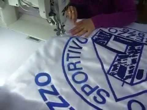 Embroidery Banner trimming finishing touches by www.aremitaly.com