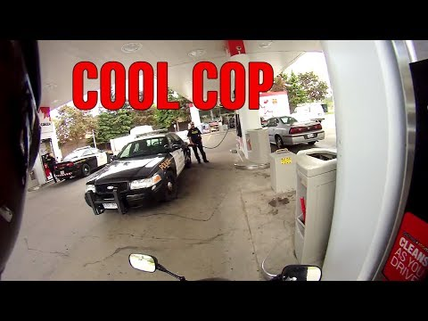 cool cop talking to motorcycle rider..stunt safe!