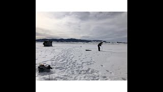 Ice fishing Granite reservoir in Wyoming s Curt Gowdy State Park