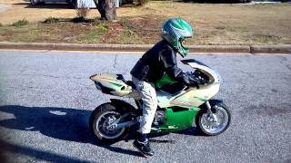 8 year old on mini motorcycle