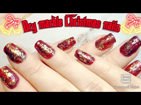 Simple Christmas nail art tutorial: Dry marble with gold flakes #christmasnailart thumbnail