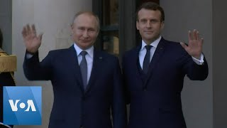 Russian President Putin Welcomed by French President Macron Prior to Peace Talks