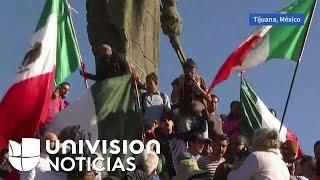 Tras la llegada masiva de migrantes a Tijuana, residentes de la zona salen a las calles a protestar.