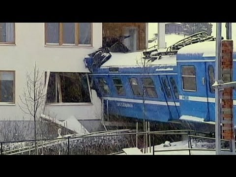 Cleaner drives Swedish train and crashes into building