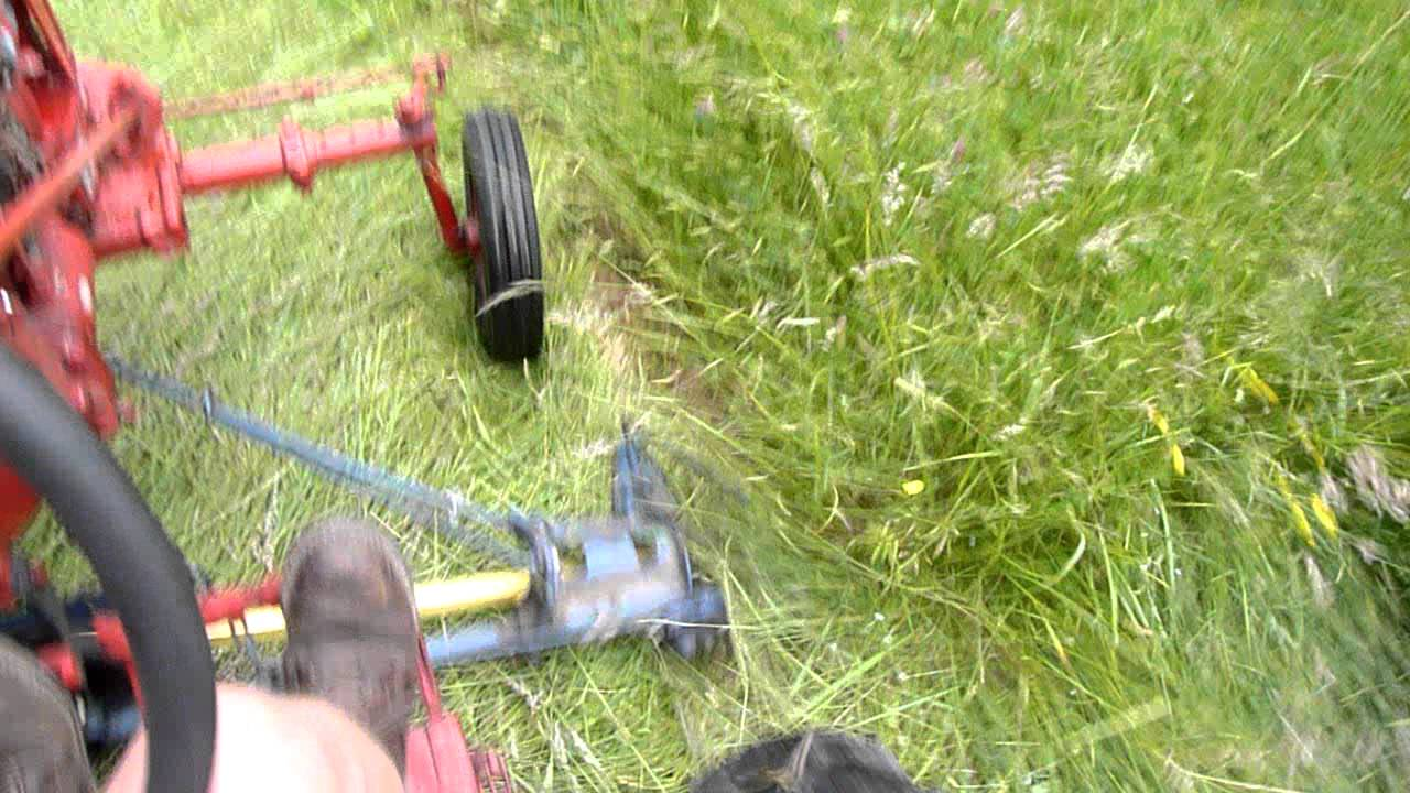 mowing with farmall cub 22 mower mov