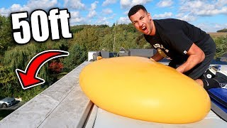 DROPPING GIANT 6ft WATER BALLOON OFF THE HOUSE!!