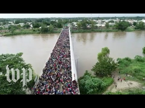 Central Americans in caravan cross into Mexico from Guatemala