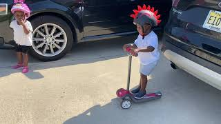 Toddler Falls Off His Scooter While Riding It Down The Driveway