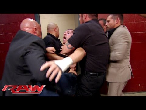 Security restrains a seething Dean Ambrose: Raw, Sept. 22, 2014