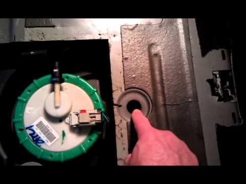 Cutting a PT Cruiser fuel pump access hole - REMOVE THE TANK STRAP