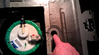 Cutting a PT Cruiser fuel pump access hole - REMOVE THE TANK STRAP BOLTS  FIRST TO LOWER THE TANK.