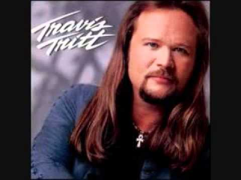 Travis Tritt - Love Of A Woman (Down The Road I Go)
