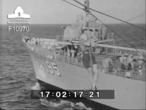 HMAS Melbourne flys aricraft and refuells from HMAS Supply