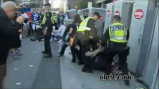Fan attacks guy on porta potty, gets beat down by cop - Vancouver Riot