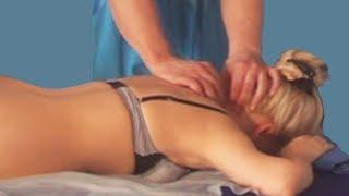 Разминание шейного отдела позвоночника в положении лёжа на животе при проведении лечебного массажа