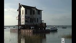Ma Barker House Floats Across Lake Weir To Its New Home