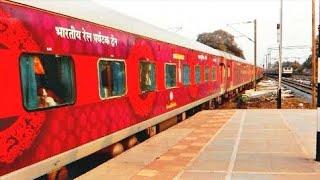 Raspberry livery IRCTC tourist train  meets Mumbai Rajdhani : Indian railways
