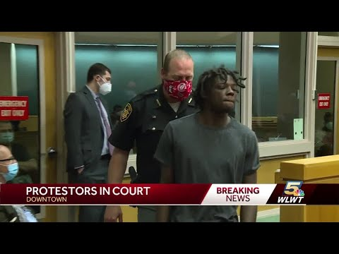 People arrested during protests, unrest line up outside courthouse downtown for processing
