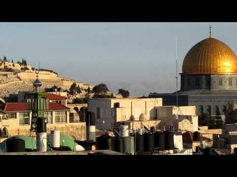 A rare view from Jerusalem - the Dome of the Rock and in the background of the mountains of Jordan