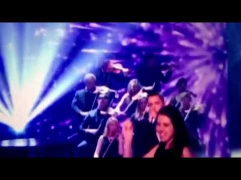 Simon Cowell gets eggs thrown at him by violinist Natalie Holt