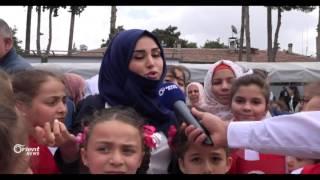 طلاب مدرسة أورينت يشاركون الأطفال الأتراك فرحتهم في عيد الطفولة في الريحانية