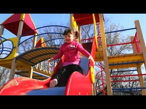 Thumbnail: Kids playground with slide, carousel and other toys Children playing on the playground