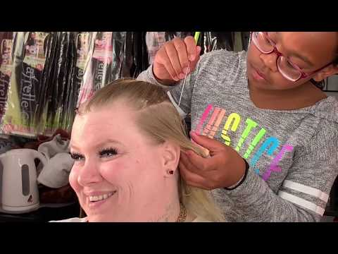 12-year-old Onnaslay braiding woman's hair for the first time.