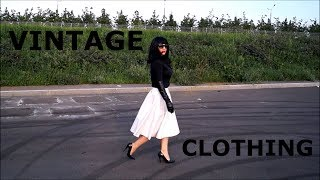 I'm in vintage 60's clothing-a leather long skirt, leather gloves and laqured high-heeled shoes