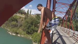 man jumps off a bridge and goes into shooting stars