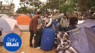 Conditions worsen for migrants taking shelter at sports complex