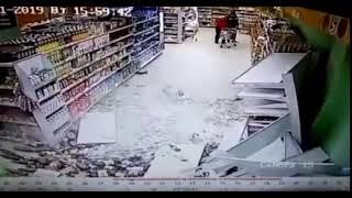 Supermarket Booze Aisle Shelves Collapse As Man Walks By