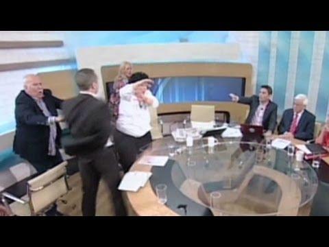 Greek politician throws water, smacks female opponent