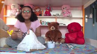 Sanjana makes an erupting volcano with theBhai Phota gift from her little brother