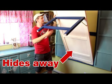 space-saving-drop-down-table.-you-can-make-this-diy-fold-down-work-table!