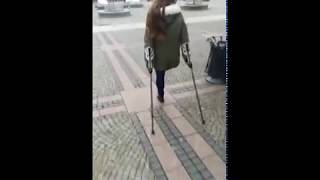 Amputee Onelegged Walking On Crutches