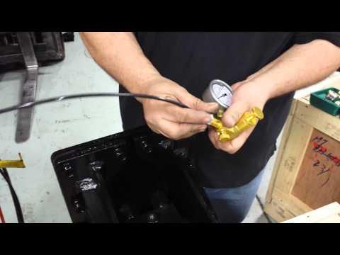 Setting gas pressure on hydraulic breaker