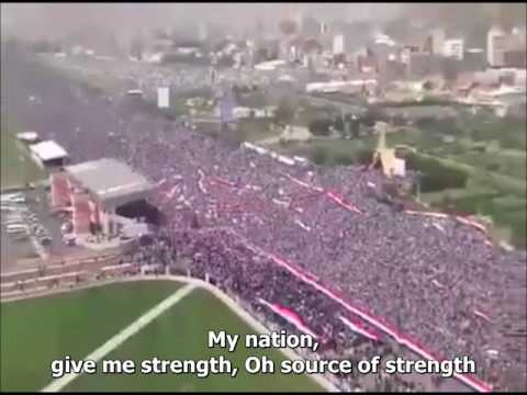 People repeat the Yemeni National Anthem during demonstratio