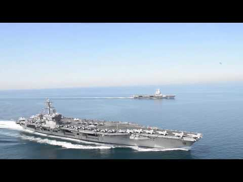 Chairman JCS General Dempsey visits French Aircraft Carrier during USS Carl Vinson operations