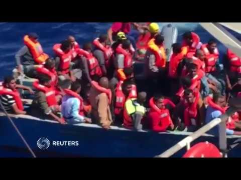 'Stop! Go back!' - Libyan coastguard board migrant rescue ship