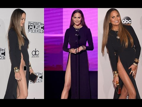 Chrissy Teigen apologizes for showing her 'hooha' on AMAs red carpet.