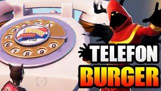 Wähle die Nummer von Durrr Burger am großen Telefon westlich von Fatal Fields | Fortnite