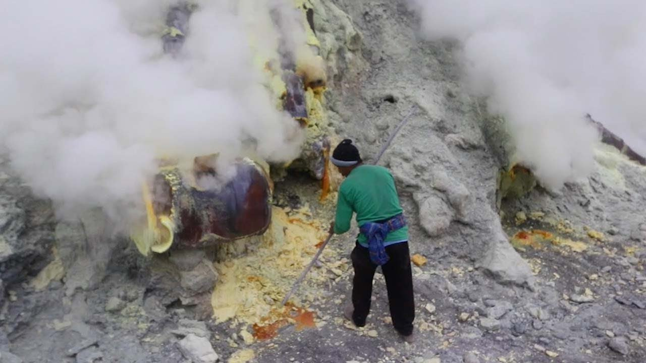Miners in hellish conditions extract sulfur in the crater of a volcano 68