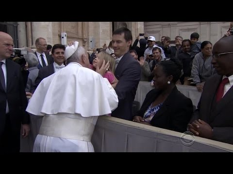 Little girl grabs Pope Francis' skullcap