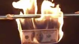 $100 Bill Up in Flames